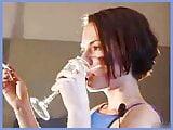 Girl smokes and drinks upclose